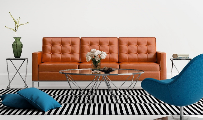 Orange sofa with blue chairs complementary colour