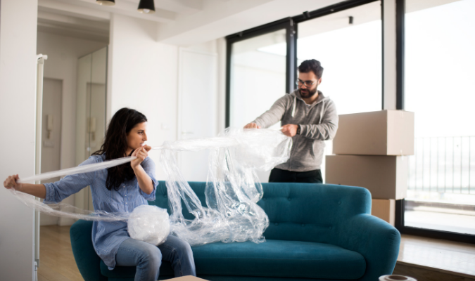Protecting sofa with bubble wrap for moving
