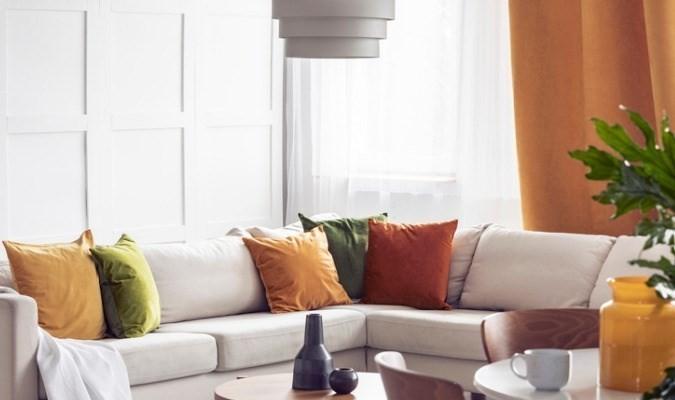 White sofa with coloured cushions