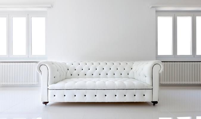Pristine white leather sofa deep conditioned