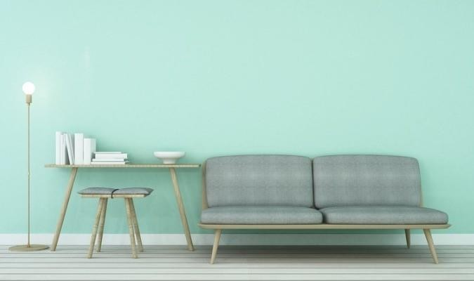 Mint green living room with grey couch