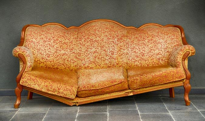 Old sofa with broken frame
