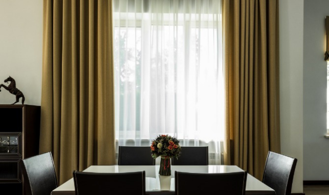 Thick Curtain Fabric Hung Up In The Dining Room