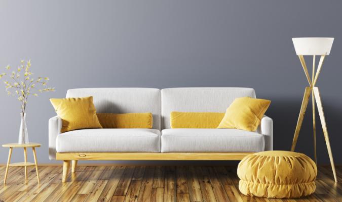 Cream sofa with yellow footstool
