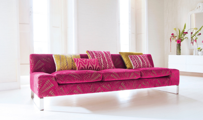 Fibre filled pink sofa with cushions