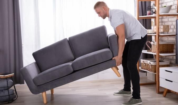 Man checking the quality of his sofa frame