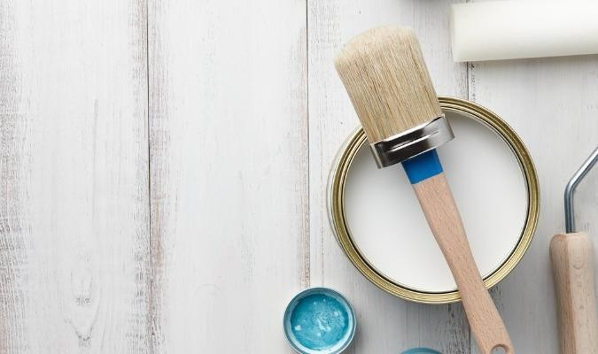 A tin of paint for cheap living room ideas