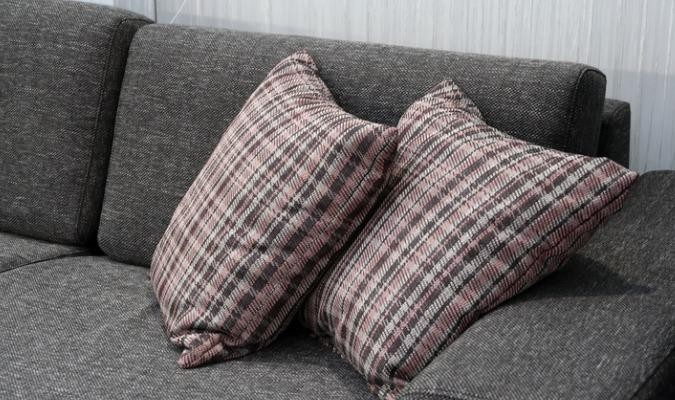 Quality sofa with plaid scatter cushions