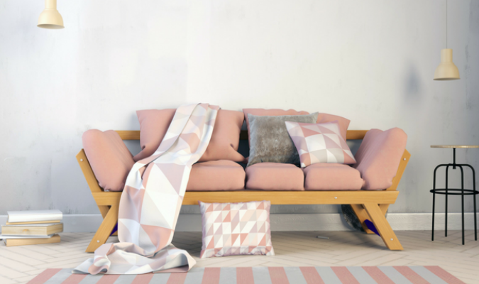 Scatter cushions and a matching throw blanket on a sofa