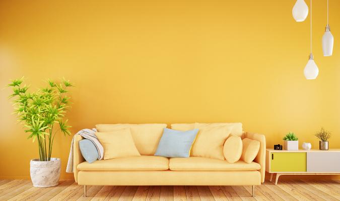 Yellow Sofa Against Yellow Wallpaper