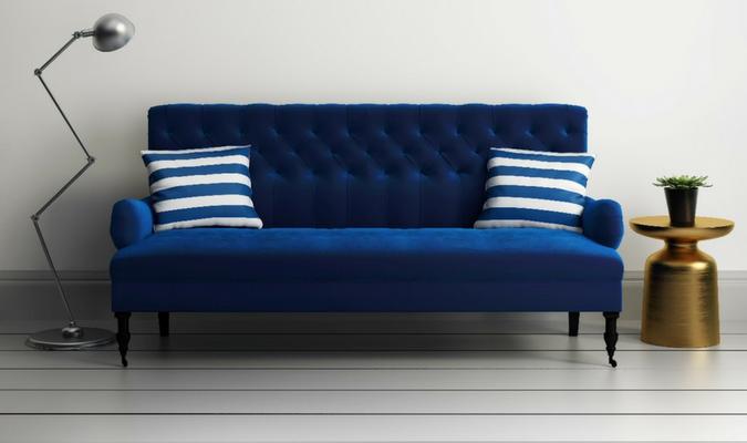 Practical blue velvet sofa with cushions