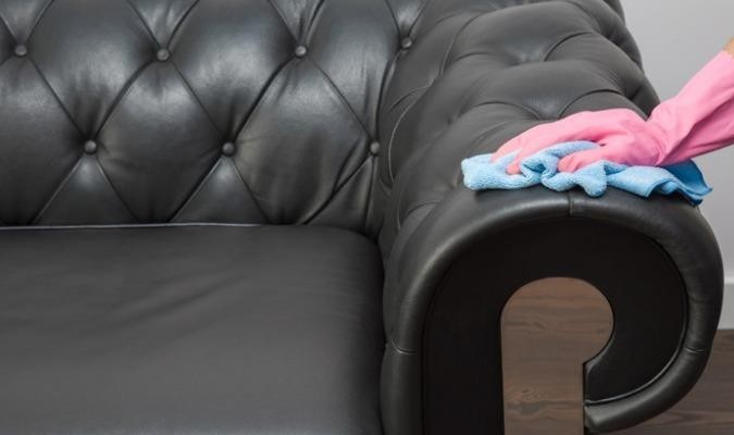 A leather sofa being polished